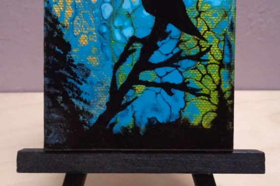 Hummingbird painting on easel